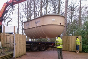 Unloading_a_large_sewage_plant